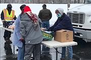 Sharon Mierzwa distributing food