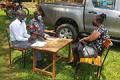 PULESA-UGANDA team members interview study participant.